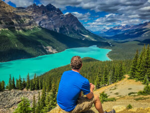 Self-portrait taken on a road-trip through Canada. This is Peyto Lake in Banff National Park - Alberta, Canada. Lifestyle Blogger. Lifestyle Influencer. Lifestyle Photography.
