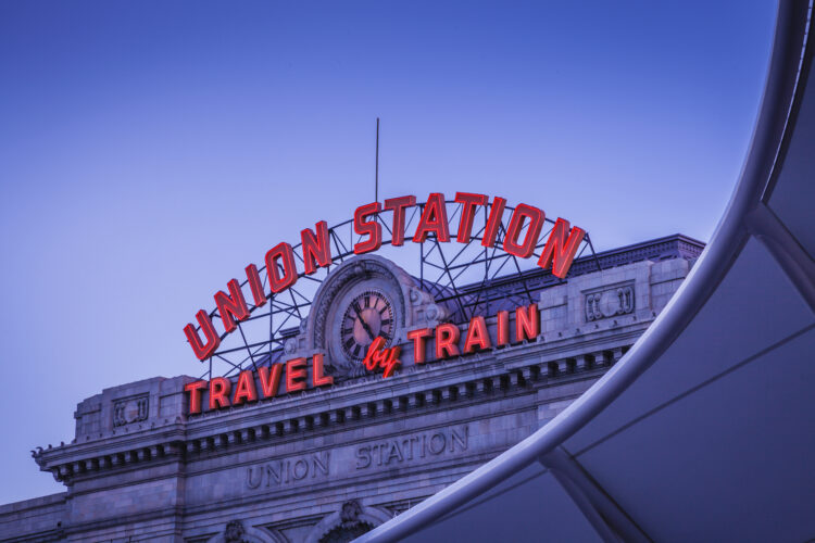 City photograph of Union Station in Denver, Colorado at dusk.