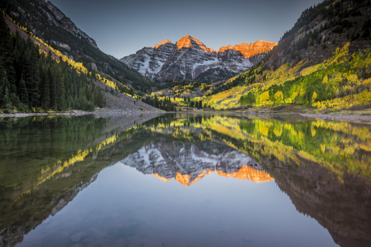 Landscape photograph of Maroon Bells outside of Aspen, Colorado at sunrise during fall.